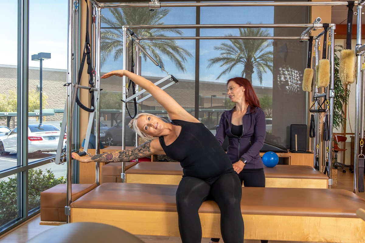 Prenatal Pilates lateral stretch on the Cadillac